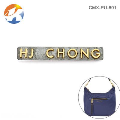 东莞厂家开发定制 箱包五金优德88娱乐官网 手袋皮具logo 浅金色散字母标牌